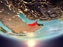 United Arab Emirates with sun. United Arab Emirates during sunrise highlighted in red on planet Earth with clouds. 3D illustration. Elements of this image Royalty Free Stock Image