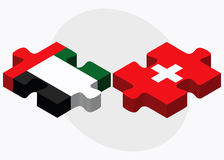 United Arab Emirates and Switzerland Flags in puzzle isolated on white background Royalty Free Stock Photography