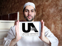 United Artists, UA film studio logo. Logo of the american United Artists, UA film studio on samsung tablet holded by arab muslim man Royalty Free Stock Photography
