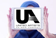 United Artists, UA film studio logo. Logo of the american United Artists, UA film studio on samsung tablet holded by arab muslim woman Royalty Free Stock Images