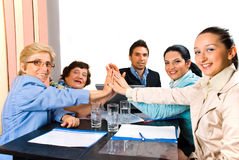 United business people team high five. Group of business people giving high five and smiling  at  meeting or team spirit,check also Business people Royalty Free Stock Image