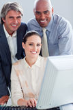 United business people working at a computer Stock Image