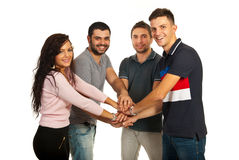 United cheerful friends. Standing with their hands on top each other isolated on white background Royalty Free Stock Photos
