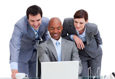 United colleagues looking at a laptop Royalty Free Stock Photography
