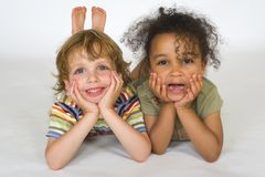 United Colors. A beautiful mixed race girl and a blonde boy playing together Stock Photography