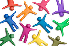 United colors-35. Multicolored plasticine human figures on a white background Royalty Free Stock Photo