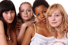 United colors. Four ethnic women in studio Royalty Free Stock Images