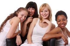 United colors. Four ethnic women in studio Stock Photos
