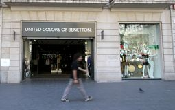 United Colors of Benetton. A young man passing by United Colors of Benetton shop in Barcelona, Spain royalty free stock images