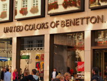United Colors of Benetton. Store with people walking by Stock Photography