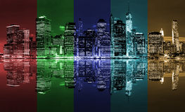 United colors of New York City. Panoramic night view of New York City with reflection in water and colored lanes Royalty Free Stock Photography