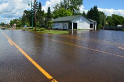 United Country Real Estate in Flood. Moose Lake, MN - June 22, 2012 - United Country Real Estate on Arrowhead Lane surrounded by flood waters Royalty Free Stock Photography