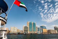 United Emirates flag with Old Dubai in background Royalty Free Stock Photos