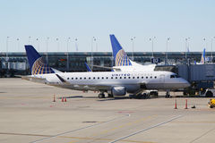 United Express Embraer plane on tarmac at O'Hare International Airport in Chicago Stock Photo