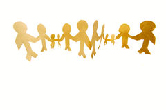United Family. Paper cutout of a united family standing together holding hands, isolated on a white background Royalty Free Stock Photography
