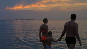 United Family Going to Swim in the Sea after Sunset stock footage