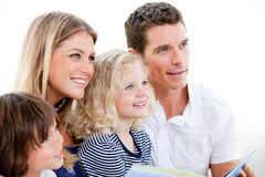 United family reading a book Royalty Free Stock Photos