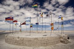 United Flags. Different country flags blowing in the wind. Taken near Uyuni on the Salar de Uyuni (salt flats), Bolivia royalty free stock photo