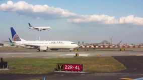 United flights landing and taking off. stock footage