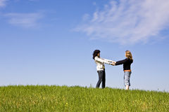 United friends. Couple of united friends on idyllic spring landscape Royalty Free Stock Images