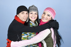 United friends friendship. Happy group of people  friends dressed in winter clothes  standing embrace  and smiling together concept of united friendship over Royalty Free Stock Image
