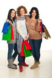 United friends at shopping. United three friends women holding shopping bags and standing in embrace Stock Image