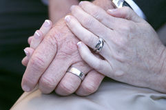 United hands. Hands of newly married couple showing rings Royalty Free Stock Photos