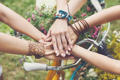 United hands of girlfriends closeup, young girls in boho bracelets. United hands of young females. Stylish hands of girlfriends in boho hippie bracelets near stock photography