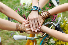 United hands of girlfriends closeup, young girls in boho bracelets. Girl Friendship. United hands of young females. Stylish girlfriends in boho hippie bracelets royalty free stock photos