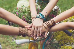 United hands of girlfriends closeup, young girls in boho bracelets. Girl Friendship. United hands of young females. Stylish girlfriends in boho hippie bracelets stock photo