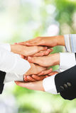 United hands over green background Royalty Free Stock Photo
