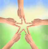 United hands over nature background. Conceptual photo of teamwork Royalty Free Stock Images