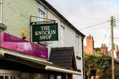 Editorial: Sign for the Knockin Shop pun of Knocking Shop. UNITED KINGDOM – SEPTEMBER 16 Sign for the Knockin Shop pun of Knocking Shop on September 16 royalty free stock images