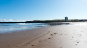 United Kingdom Aberdeen beach. With lighthouse in the background , north of Scotland royalty free stock images