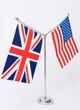 United Kingdom and american table flag. On white stock photo