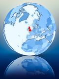United Kingdom on blue globe. On reflective surface. 3D illustration royalty free illustration