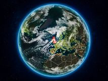 United Kingdom on Earth at night. United Kingdom from space on planet Earth at night with visible country borders. 3D illustration. Elements of this image Royalty Free Illustration