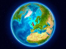 United Kingdom on Earth. United Kingdom in red from Earth's orbit. 3D illustration. Elements of this image furnished by NASA Royalty Free Stock Images