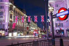 United Kingdom, England, London - 2016 June 17: Popular tourist Picadilly circus with flags union jack in night lights Stock Photo