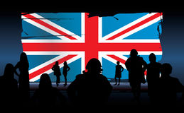 United kingdom flag. Silhouettes of people in front of an united kingdom flag Stock Photo