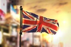 United Kingdom Flag Against City Blurred Background At Sunrise B Royalty Free Stock Photo