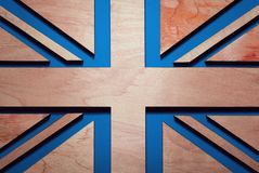 United Kingdom flag, background, illustration, stripes carved from wood, blue background royalty free stock images