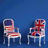 United Kingdom flag chair and USA flag chair on blue background with copy space. Digital illustration.3d rendering Royalty Free Stock Photo