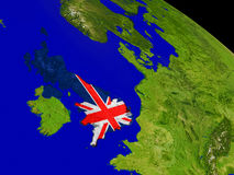 United Kingdom with flag on Earth Stock Images