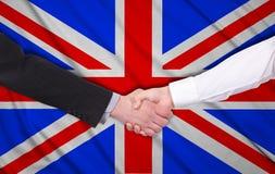 United kingdom flag. Handshake on a united kingdom flag background Royalty Free Stock Image