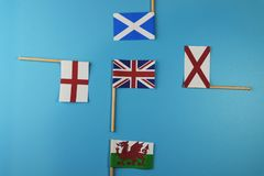A United kingdom flag and her members as Scotland, England, Nothern Ireland, Wales. Blue background royalty free stock photos