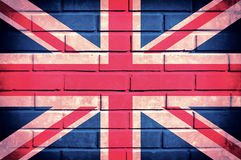 United Kingdom. Flag of United Kingdom on the old brick wall Stock Photos