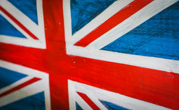 United Kingdom flag painted on aged wooden wall . Stock Photos