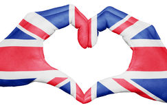 United kingdom flag painted on hands forming a heart isolated on white background, UK national and patriotism concept Royalty Free Stock Image