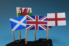 A United kingdom flag and their members as Scotland, England, Nothern Ireland, Wales. Blue background royalty free stock photos